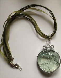 Rutliated glass with thick silver frame necklace