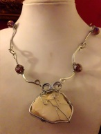 Beach Stone Wrapped in Thick Wire Frame and Hand Forged Hammered Silver Links Wrapped with Lavender Crystals