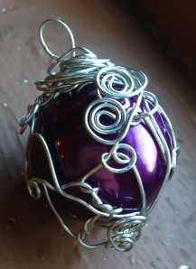 A rich purple sphere is wrapped in silver goddess spirals - you NEED to see this in person!