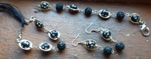 Black spheres with silver stars embraced by pewter bead cages.  I LOVE the textured black sphere accents as well!