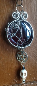 The Deception of Crowley - blood red glass framed in silver, complemented by a pentagram and skull! Available at www.eldwenne.etsy.com